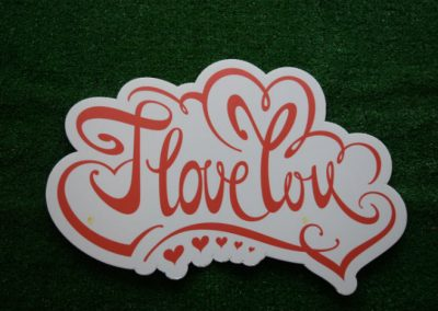 I love you yard art orange word saying
