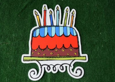 Birthday boys primary cake with candles yard sign