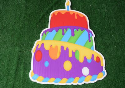 Birthday lopsided cake purple red yellow yard sign