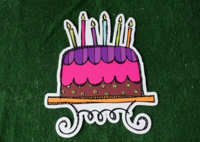 Birthday pink purple cake with candles yard sign