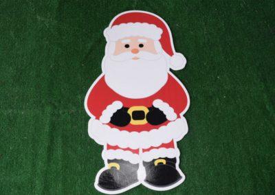 Christmas Santa standing holding belt yard sign