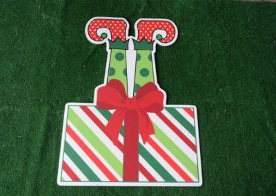 Christmas elf legs in present yard sign