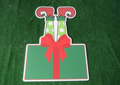 Christmas green present with elf legs yard sign