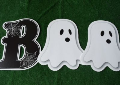 black B with spider webs and ghosts BOO yard signs