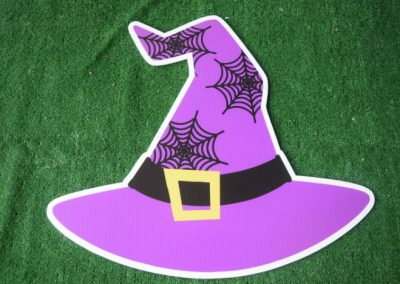 purple witch hat yard sign
