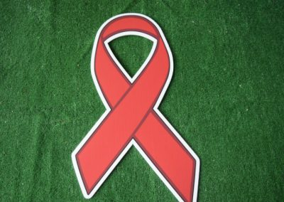 red cancer ribbon yard sign
