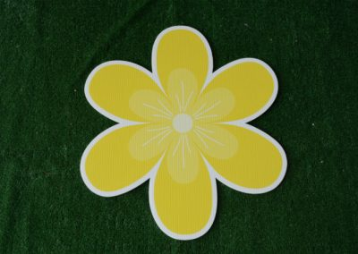 yellow tropical flower yard sign